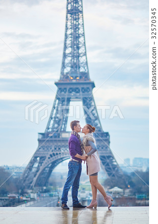 Couple near the Eiffel tower in Paris 32570345