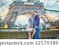 Couple near the Eiffel tower in Paris 32570380