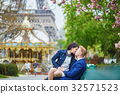Romantic couple in Paris near the Eiffel tower 32571523