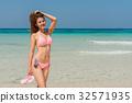 Sexy bikini body woman sun tanning relaxing  32571935