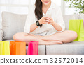 woman shopping with smartphone and smartwatch 32572014
