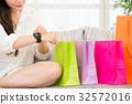 charming asian woman enjoy online shopping 32572016