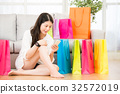 woman shopping with smartphone and smartwatch 32572019