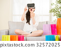 asian woman feel surprise shopping online with VR 32572025