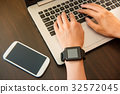 woman wearing smartwatch on the computer 32572045