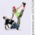 Teenagers dancing breakdance in action 32574226