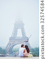 Romantic couple together in Paris 32574584