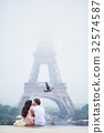 Beautiful romantic couple near the Eiffel tower in Paris 32574587