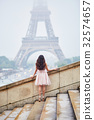 Parisian woman in front of the Eiffel tower 32574657