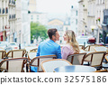 Couple in outdoor cafe on Montmartre, Paris, France 32575186