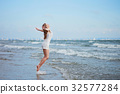 Young woman enjoying her vacation by sea 32577284