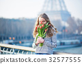 Girl with bunch of red tulips near the Eiffel tower 32577555