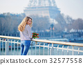Girl with bunch of red tulips near the Eiffel tower 32577558