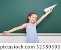 Pupil posing at school board, education concept  32580393