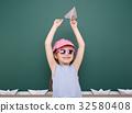 Pupil posing at school board, education concept  32580408