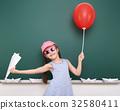 Pupil posing at school board, education concept  32580411