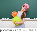Pupil posing at school board, education concept  32580414