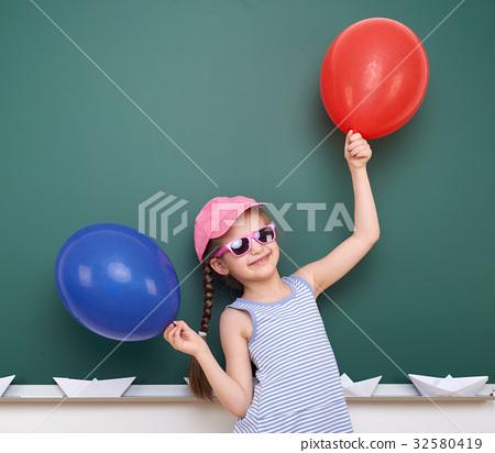Pupil posing at school board, education concept  32580419