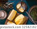 Peeled pineapple, lemon and rosemary for jam 32582162