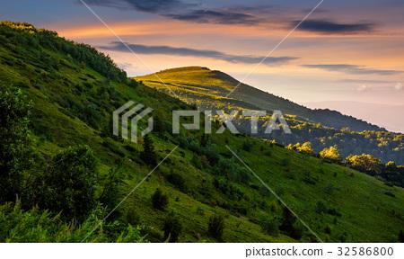 mountain ridge with peak at sunset 32586800