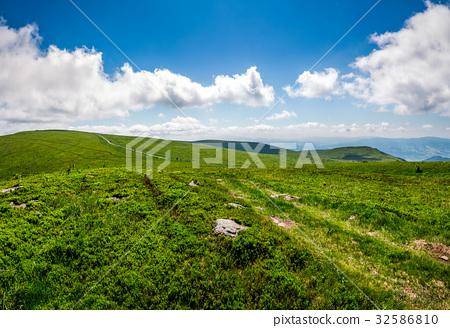 path through hillside in high mountains 32586810