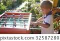 children playing table football outdoors.Fun 32587280
