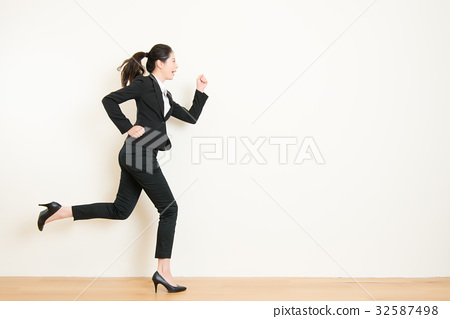 businesswoman with running on white background 32587498