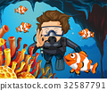 Scuba diver diving underwater with clownfish 32587791