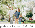 young family on the street 32590243