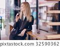 beautiful blonde in a cafe 32590362