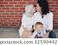 beautiful young family 32590442