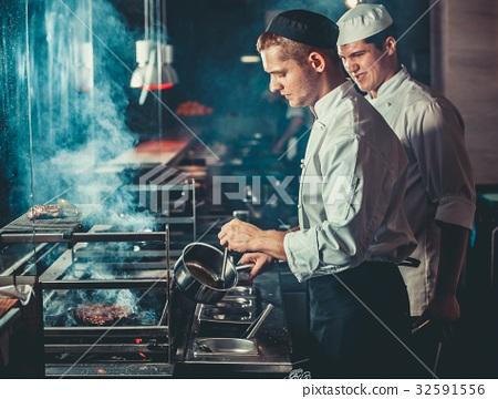 Preparing traditional beef steak 32591556