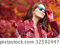 season and people concept - beautiful happy young woman walking 32592447