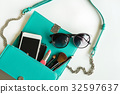 Woman handbag with makeup and accessories 32597637