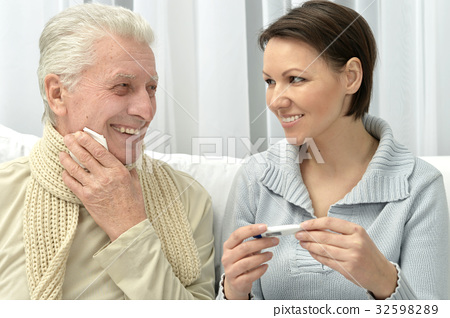 woman taking care of ill man 32598289