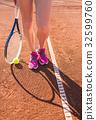 Female legs with tennis racket 32599760