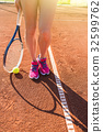 Female legs with tennis racket 32599762