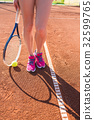 Female legs with tennis racket 32599765