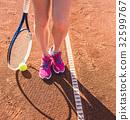 Female legs with tennis racket 32599767