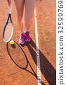 Female legs with tennis racket 32599769