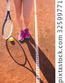 Female legs with tennis racket 32599771