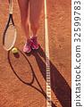 Female legs with tennis racket 32599783