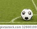 Soccer ball in the corner of football field 32600109