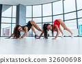 Sporty young women attending gymnastics classes 32600698
