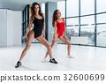 Sexy Caucasian women wearing bodysuits dancing 32600699