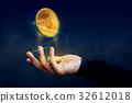 Golden Money Coin float over Magician hand 32612018