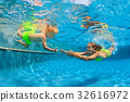 Happy family diving underwater in swimming pool 32616972