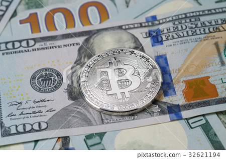 Picture of dollars with silver bitcoin 32621194