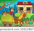 Hay cart with farmer near stable 32622867