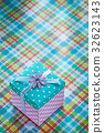 Packed gift box on checked textile holidays 32623143